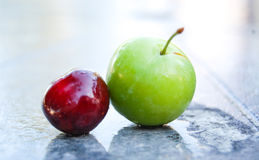 Ripe red cherry and plum Royalty Free Stock Photography
