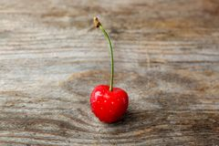 Ripe red cherry with water drops Stock Photo