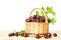 Ripe red cherry in a wicker basket Royalty Free Stock Photo