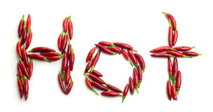 Ripe red chili peppers shaped in the word Hot Royalty Free Stock Photo