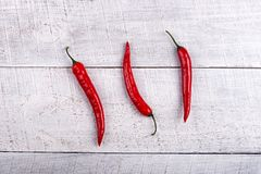 Ripe Red Chilli Peppers on table stock image