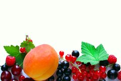 Ripe red currant black currant raspberries and cherry on a white background. Royalty Free Stock Photos