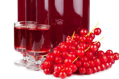 Ripe red currants and liqueur Royalty Free Stock Photos