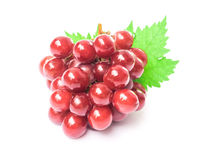 Ripe red grape with leaf on white background, fruit healthy conc Royalty Free Stock Photo