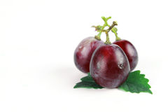 Ripe red grape with leaves Royalty Free Stock Photos