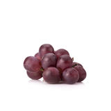 Ripe red grape with leaves isolated on white Royalty Free Stock Photography