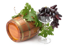 Ripe red grapes. Glass of red grapes , grapevine and wooden keg isolated on white background Stock Image