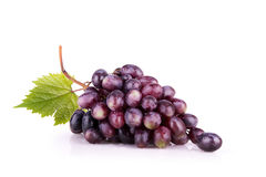 Ripe red grapes with leaves. Isolated royalty free stock images