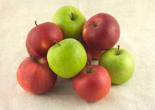 Ripe red and green apples on beige cloth closeup Royalty Free Stock Photo