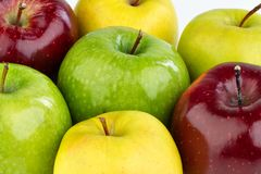 Ripe red, yellow and green apples on white background. Ripe red, green and yellow apples, different colors apples, closeup background stock image