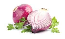 Ripe red onions and parsley. On white background stock images