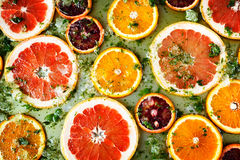 Ripe red oranges and grapefruits cut by rings Royalty Free Stock Image