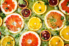 Ripe red oranges and grapefruits cut by rings Stock Photo