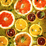 Ripe red oranges and grapefruits cut by rings Stock Photos