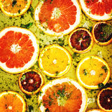 Ripe red oranges and grapefruits cut by rings Royalty Free Stock Photo