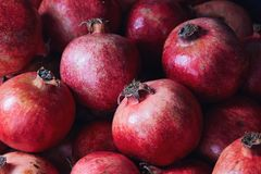 Ripe red organic pomegranates Royalty Free Stock Image