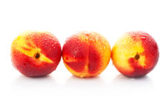 The ripe red peaches Stock Images