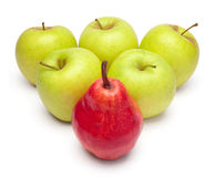 A ripe red pear and green apples. As triangle royalty free stock photography