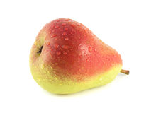 Ripe red pear on white background (water drops). Royalty Free Stock Image
