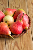 Ripe red pears on the wooden table Royalty Free Stock Photography