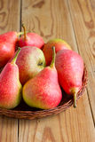Ripe red pears on the wooden table Stock Image