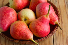 Ripe red pears on the wooden table Stock Photography