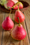 Ripe red pears on the wooden table Stock Images