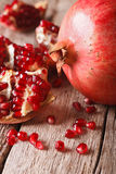 Ripe red pomegranate seeds macro on the table. vertical Stock Photo