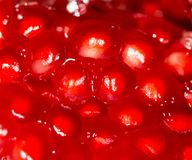 Ripe red pomegranate in water. Photo of abstract background royalty free stock photo