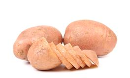 Ripe red potatoes and slices royalty free stock photography