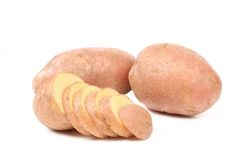 Ripe red potatoes and slices stock images