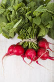 Ripe red radish with leaves on a wooden table close-up. Fresh ve. Getables. Healthy eating Stock Photos