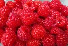 Ripe red raspberries Stock Photos