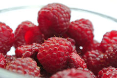 Ripe red raspberries in a glass bowl closeup Stock Image