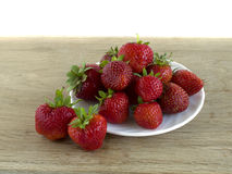Ripe red strawberries is located on wooden board. Ripe red strawberries are located on wooden board Royalty Free Stock Image