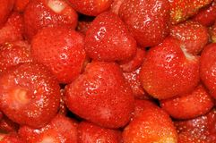 Ripe red strawberries are peeled and ready to eat. royalty free stock image