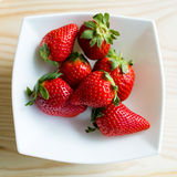 Ripe red strawberries on a plate. Portrait of ripe red strawberries on a plate Royalty Free Stock Photography