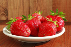 Ripe red strawberries on the plate Royalty Free Stock Image