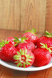 Ripe red strawberries on the plate Stock Image