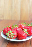Ripe red strawberries on the plate Royalty Free Stock Photo