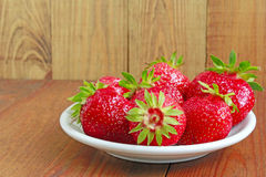 Ripe red strawberries on the plate Stock Photography