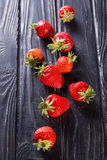 Ripe red strawberries. Some raw ripe red strawberries on black background in studio royalty free stock image