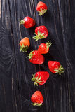 Ripe red strawberries. Some raw ripe red strawberries on black background in studio royalty free stock photos