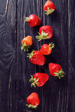 Ripe red strawberries. Some raw ripe red strawberries on black background in studio stock photography