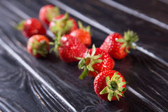 Ripe red strawberries. Some raw ripe red strawberries on black background in studio royalty free stock images