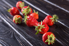 Ripe red strawberries. Some raw ripe red strawberries on black background in studio stock photo