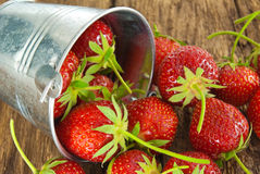 Ripe red strawberries on a wooden background Royalty Free Stock Photo