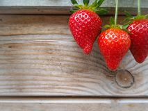 Ripe red strawberries on a wooden background royalty free stock photos