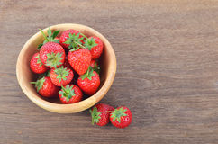 Ripe red strawberries on wooden table. Red strawberries on wooden table Stock Image