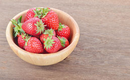 Ripe red strawberries on wooden table. Red strawberries on wooden table Royalty Free Stock Image